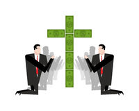 Businessman praying for money. Adoration of dollars. Financial i Stock Image