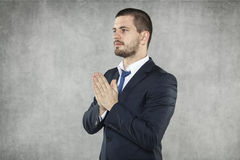 Businessman praying for success in business Royalty Free Stock Images