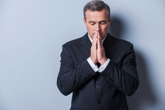 Businessman praying. Royalty Free Stock Photography