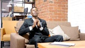 Businessman Praying To God. High quality Stock Photography