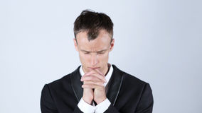 Businessman Praying to God. High quality Royalty Free Stock Photo