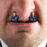 Businessman predator. Businessmen instead of fangs Stock Images