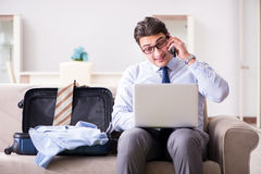 The businessman preparing for the business trip. Businessman preparing for the business trip Stock Image