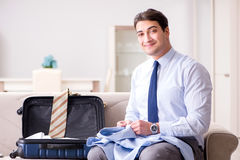 The businessman preparing for the business trip. Businessman preparing for the business trip Royalty Free Stock Photos