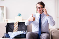 The businessman preparing for the business trip Stock Image