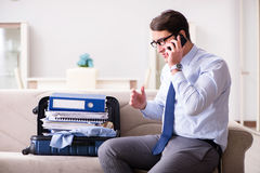 The businessman preparing for the business trip. Businessman preparing for the business trip Stock Photography