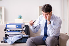 The businessman preparing for the business trip. Businessman preparing for the business trip Stock Photo