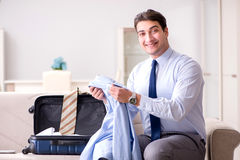 The businessman preparing for the business trip. Businessman preparing for the business trip Royalty Free Stock Photo