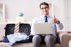 The businessman preparing for the business trip. Businessman preparing for the business trip Royalty Free Stock Image