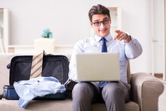 The businessman preparing for the business trip Stock Photography