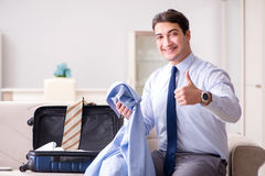 The businessman preparing for the business trip Royalty Free Stock Image