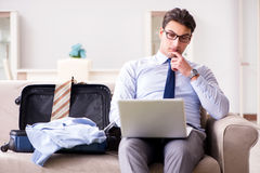 The businessman preparing for the business trip. Businessman preparing for the business trip Royalty Free Stock Images