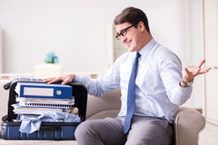 The businessman preparing for the business trip. Businessman preparing for the business trip Stock Images