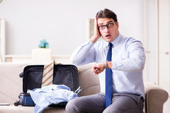The businessman preparing for the business trip Royalty Free Stock Photos