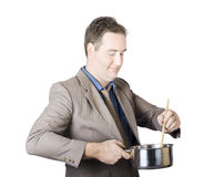 Businessman Preparing Food Stock Photography