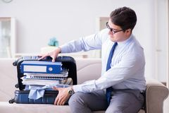 The businessman preparing packing for business trip. Businessman preparing packing for business trip Royalty Free Stock Photo