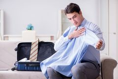 The businessman preparing packing for business trip. Businessman preparing packing for business trip Stock Photo