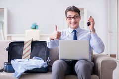 The businessman preparing packing for business trip. Businessman preparing packing for business trip Stock Images