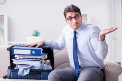 The businessman preparing packing for business trip. Businessman preparing packing for business trip Royalty Free Stock Photography
