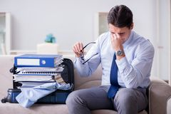 The businessman preparing packing for business trip. Businessman preparing packing for business trip Royalty Free Stock Images
