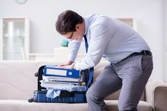 The businessman preparing packing for business trip. Businessman preparing packing for business trip Stock Photos