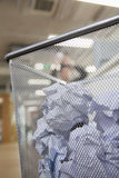 Businessman preparing to throw paper into wastepaper bin, close up on wastepaper bin Stock Photos