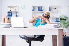 The businessman preparing for vacation in the office. Businessman preparing for vacation in the office Stock Images