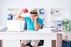 The businessman preparing for vacation in the office. Businessman preparing for vacation in the office Stock Photos
