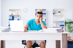 The businessman preparing for vacation in the office. Businessman preparing for vacation in the office Stock Image
