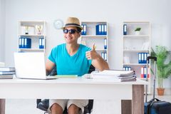 The businessman preparing for vacation in the office. Businessman preparing for vacation in the office Royalty Free Stock Photos