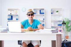 The businessman preparing for vacation in the office. Businessman preparing for vacation in the office Royalty Free Stock Images