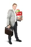Businessman with present boxes Stock Photo
