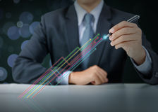 Businessman present colorful increasing graph Royalty Free Stock Image