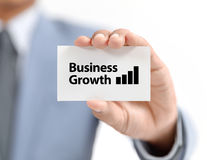 Businessman present graph with growth. On white paper Royalty Free Stock Images