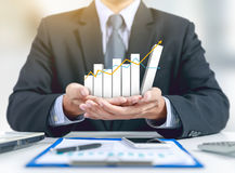Businessman Present Growing Graph On Hand With Business Plan Royalty Free Stock Image