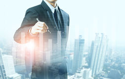 Businessman present increasing graph with city background Royalty Free Stock Photography