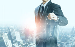 Businessman present increasing graph with city background Stock Images