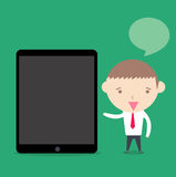 Businessman present tablet device on green background Stock Image