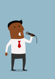 Businessman on the presentation with microphone Stock Photo