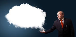 Businessman presenting abstract cloud copy space Stock Photo