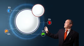 Businessman presenting abstract modern pie chart with copy space Stock Images