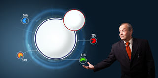 Businessman presenting abstract modern pie chart with copy space Stock Photo
