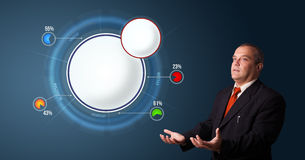 Businessman presenting abstract modern pie chart with copy space Royalty Free Stock Photography