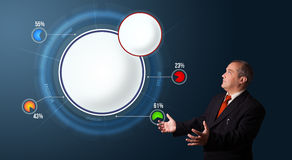 Businessman presenting abstract modern pie chart with copy space Royalty Free Stock Photos