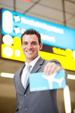 Businessman presenting air ticket Royalty Free Stock Images