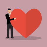 Businessman presenting the big heart Royalty Free Stock Photography