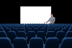 Businessman presenting at blank board in front of 3d empty chairs Stock Photos