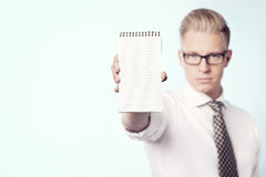 Businessman presenting blank notebook. Stock Photos