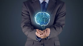 Businessman presenting brain with hands stock video