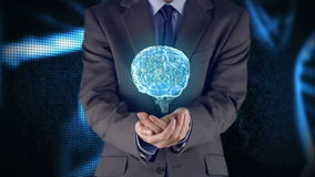 Businessman presenting brain with hands stock footage
